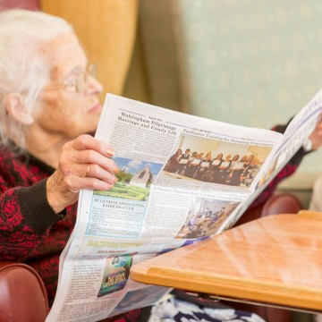 bakewell cottage nursing home resident reading newspaper